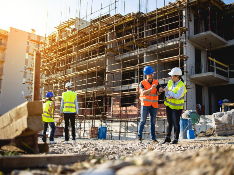 Four construction workers having meeting,stock photo